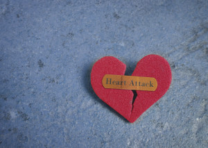 Broken red heart with a bandaid and Heart Attack text