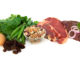 Iron-rich foods, including eggs, spinach, peas, beans, red meat, liver, and raisins.  Isolated on white.