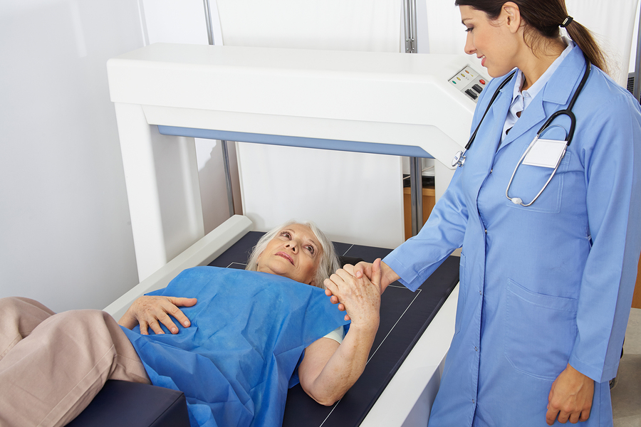 Senior Woman Holding Hand Of Doctor In Radiology While Getting B A